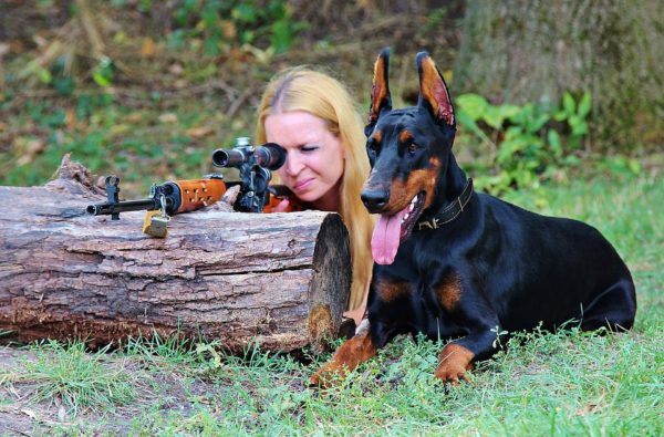 Blond Woman Hunting with Dog