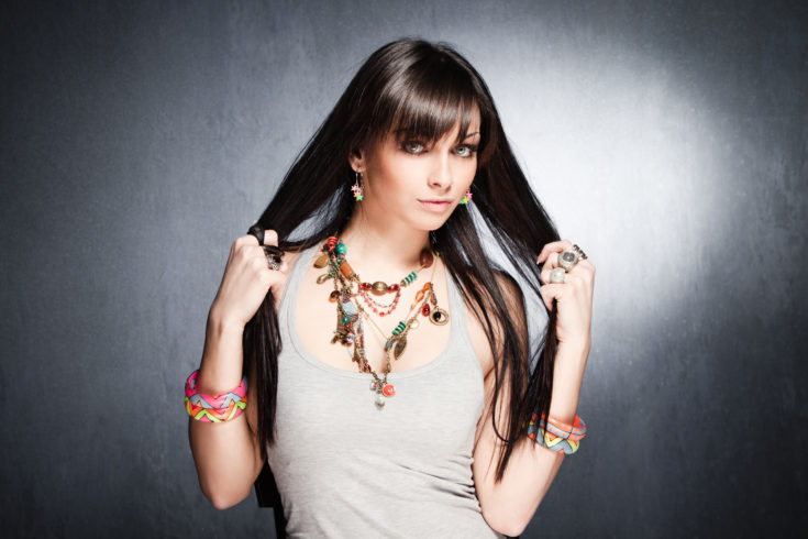 Fashion Model wearing layered necklace