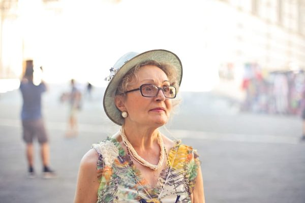 aging woman with hat and glasses