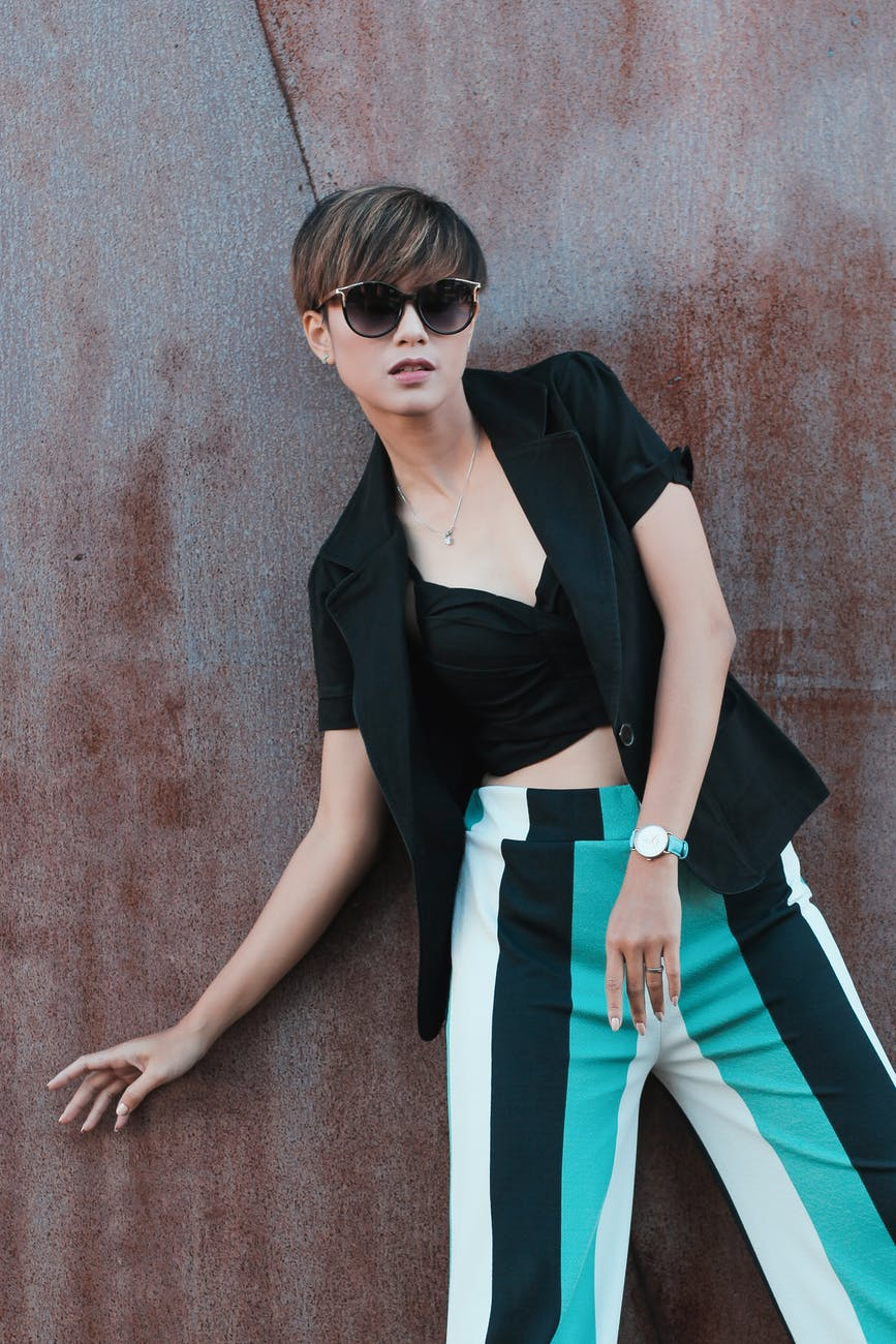 short haired asian wearing sunglasses with striped pants